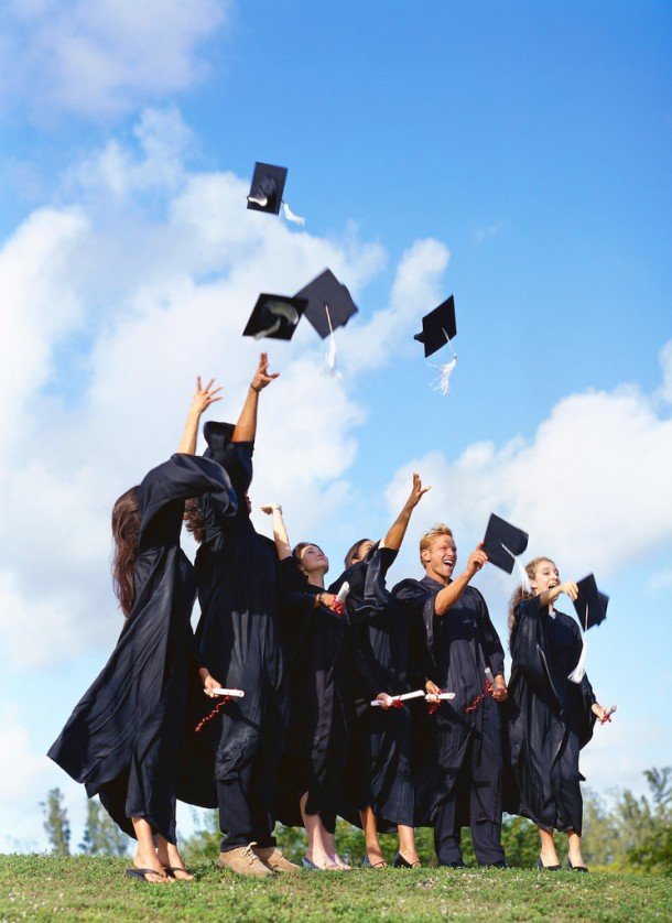 Group of Young Graduates Throwing Their Hats in the Air